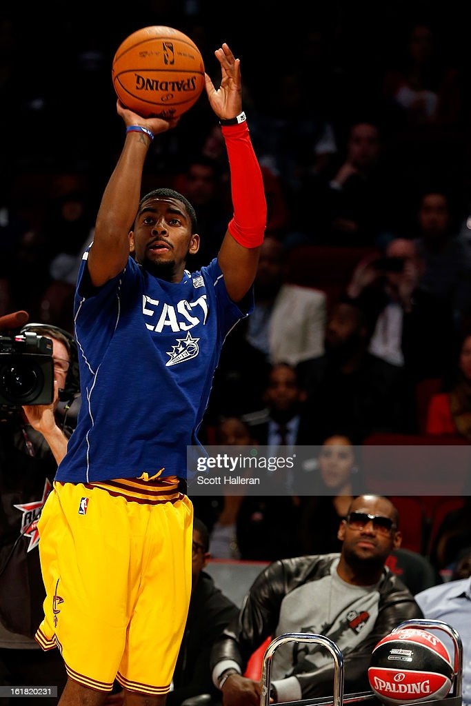 Kyrie Irving of the Cleveland Cavaliers competes as LeBron James of the Miami Heat looks on during the Foot Locker Three-Point Contest part of 2013 NBA All-Star Weekend at the Toyota Center on February 16, 2013 in Houston, Texas.