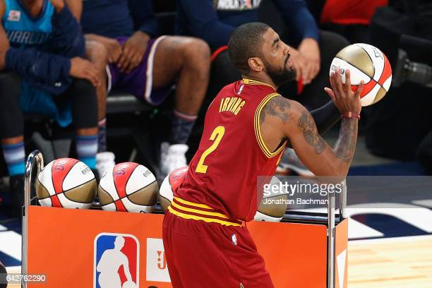 Kyrie Irving of the Cleveland Cavaliers competes in the 2017 JBL ThreePoint Contest at Smoothie King Center on February 18 2017 in New Orleans...