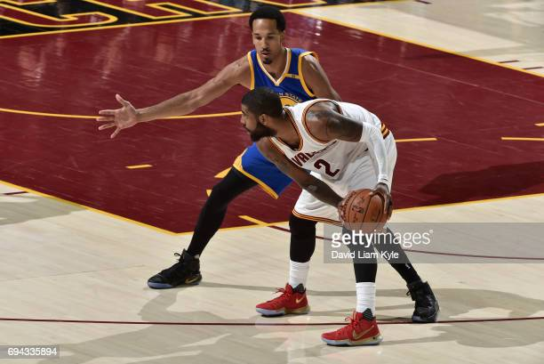 Kyrie Irving of the Cleveland Cavaliers controls the ball against Shaun Livingston of the Golden State Warriors in Game Four of the 2017 NBA Finals...