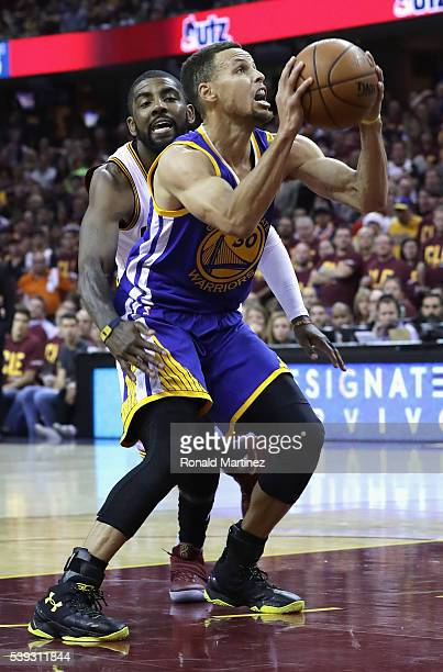 Kyrie Irving of the Cleveland Cavaliers defends Stephen Curry of the Golden State Warriors during the first half in Game 4 of the 2016 NBA Finals at...