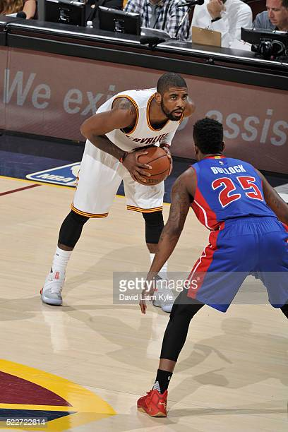 Kyrie Irving of the Cleveland Cavaliers defends the ball against Reggie Bullock of the Detroit Pistons during Game Two of the Eastern Conference...