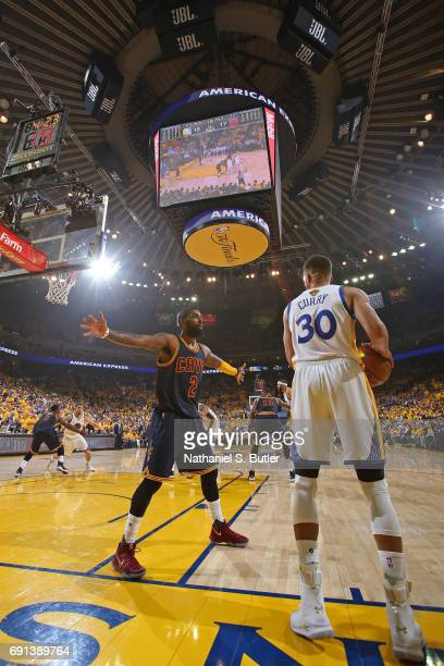 Kyrie Irving of the Cleveland Cavaliers defends the inbound pass from Stephen Curry of the Golden State Warriors in Game One of the 2017 NBA Finals...