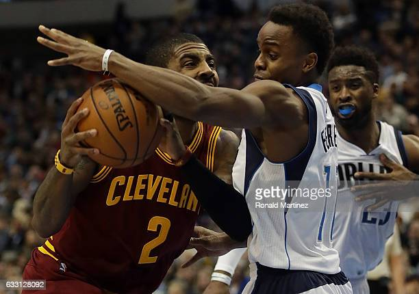 Kyrie Irving of the Cleveland Cavaliers dribbles the ball against Yogi Ferrell of the Dallas Mavericks in the first half at American Airlines Center...