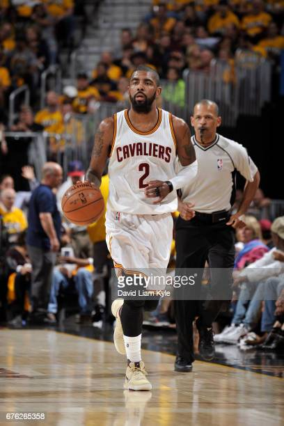 Kyrie Irving of the Cleveland Cavaliers dribbles the ball up court against the Toronto Raptors during Game One of the Eastern Conference Semifinals...