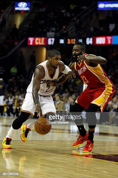 Kyrie Irving of the Cleveland Cavaliers drives against James Harden of the Houston Rockets during the second half of their game on January 7 2015 at...
