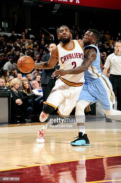 Kyrie Irving of the Cleveland Cavaliers drives against the Denver Nuggets at The Quicken Loans Arena on November 17 2014 in Cleveland Ohio NOTE TO...