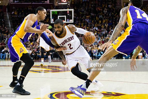 Kyrie Irving of the Cleveland Cavaliers drives between Jordan Clarkson and Brandon Ingram of the Los Angeles Lakers during the second half at Quicken...