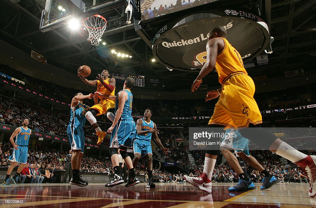 Kyrie Irving #2 of the Cleveland Cavaliers drives in for the shot against Ryan Anderson #33 and Jason Smith #14 of the New Orleans Hornets at The Quicken Loans Arena on February 20, 2013 in Cleveland, Ohio.