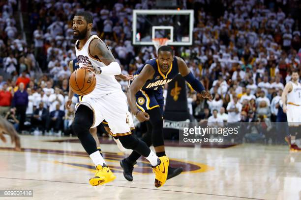 Kyrie Irving of the Cleveland Cavaliers drives past CJ Miles of the Indiana Pacers during the second half in Game Two of the Eastern Conference...