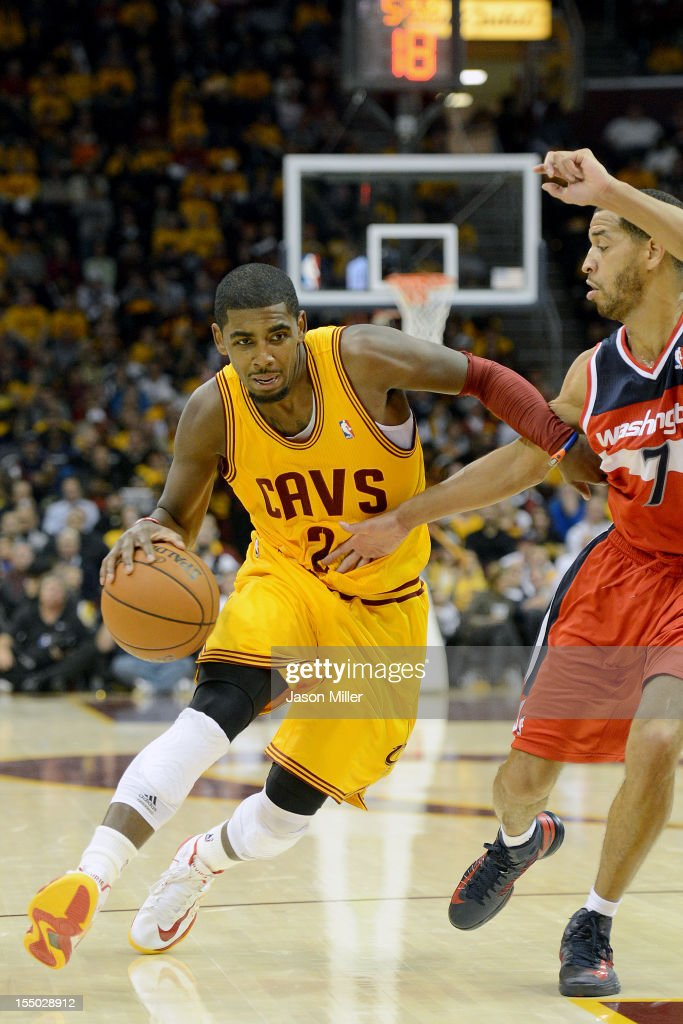 Kyrie Irving #2 of the Cleveland Cavaliers drives past Jannero Pargo #7 of the Washington Wizards during the second half at Quicken Loans Arena on October 30, 2012 in Cleveland, Ohio. The Cavaliers defeated the Wizards 94-84.