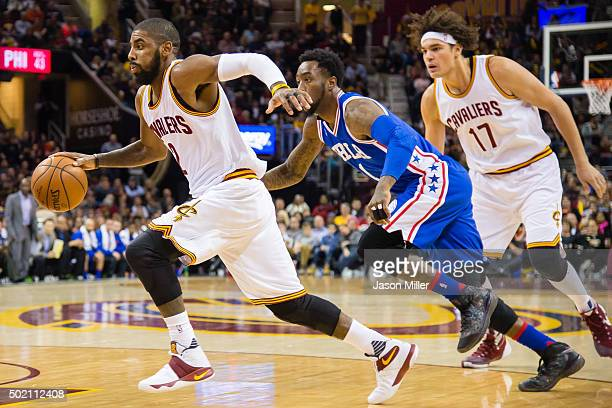 Kyrie Irving of the Cleveland Cavaliers drives past Tony Wroten of the Philadelphia 76ers during the first half at Quicken Loans Arena on December 20...