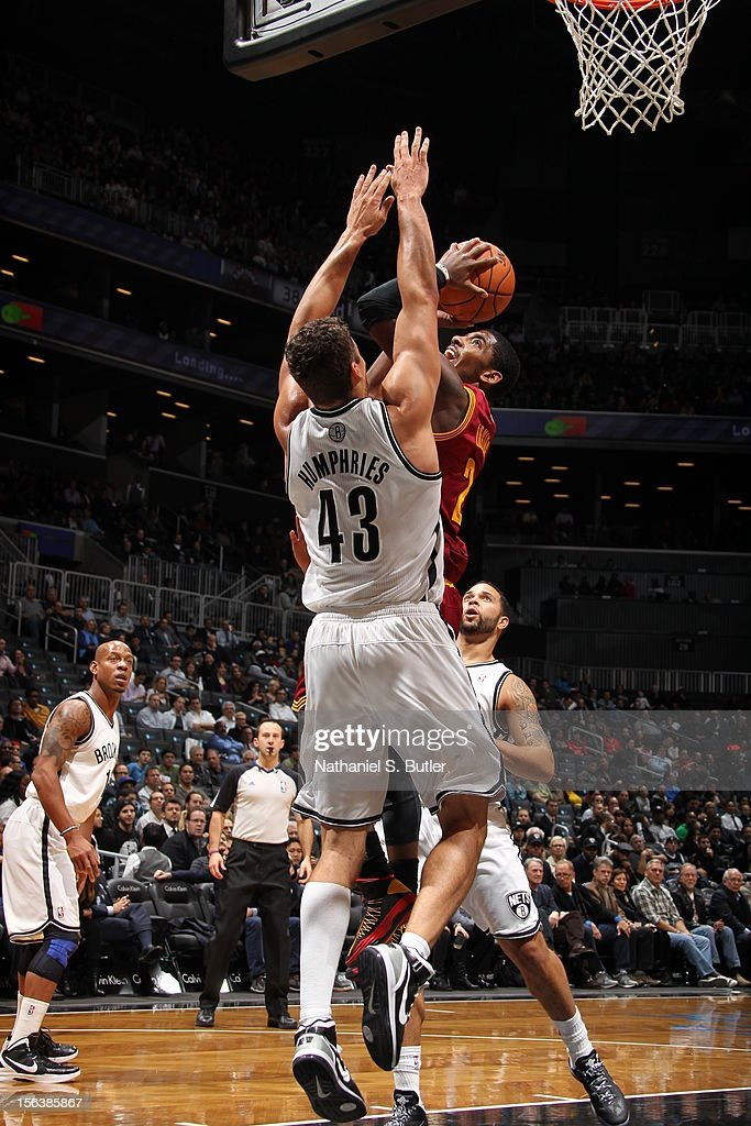 Kyrie Irving #2 of the Cleveland Cavaliers drives to the basket against Kris Humphries #43 of the Brooklyn Nets on November 13, 2012 at the Barclays Center in the Brooklyn Borough of New York City.
