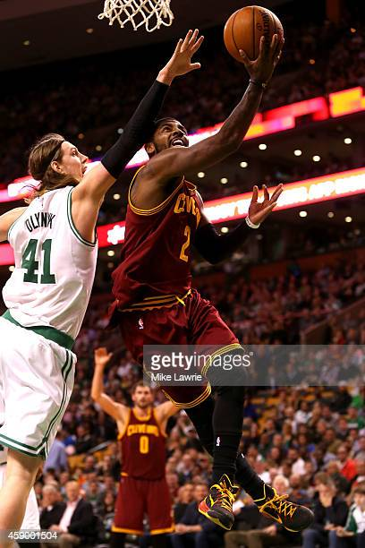 Kyrie Irving of the Cleveland Cavaliers drives to the basket against cc41 in the second half at TD Garden on November 14 2014 in Boston Massachusetts...