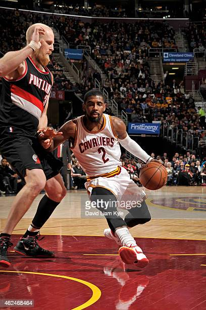 Kyrie Irving of the Cleveland Cavaliers drives to the basket against Chris Kaman of the Portland Trail Blazers on January 28 2015 at Quicken Loans...