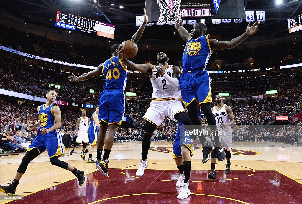 Kyrie Irving #2 of the Cleveland Cavaliers drives to the basket against Harrison Barnes #40 of the Golden State Warriors and Draymond Green #23 during the second half in Game 3 of the 2016 NBA Finals at Quicken Loans Arena on June 8, 2016 in Cleveland, Ohio.