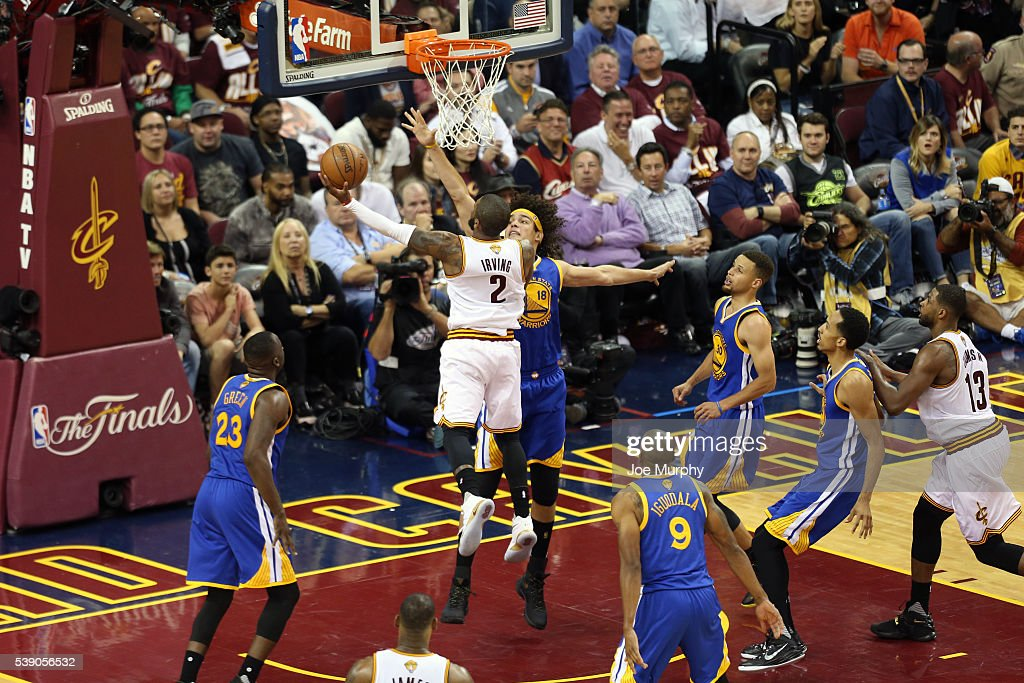 Kyrie Irving #2 of the Cleveland Cavaliers drives to the basket against Anderson Varejao #18 of the Golden State Warriors in Game Three of the 2016 NBA Finals on June 8, 2016 at The Quicken Loans Arena in Cleveland, Ohio.