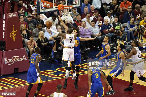 Kyrie Irving of the Cleveland Cavaliers drives to the basket against Anderson Varejao of the Golden State Warriors in Game Three of the 2016 NBA...