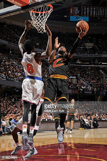 Kyrie Irving of the Cleveland Cavaliers drives to the basket against the New York Knicks on October 25 2016 at Quicken Loans Arena in Cleveland Ohio...