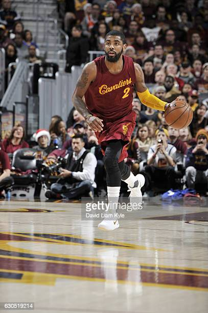 Kyrie Irving of the Cleveland Cavaliers drives to the basket against the Golden State Warriors during the game on December 25 2016 at Quicken Loans...