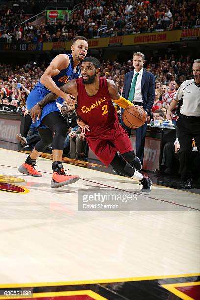 Kyrie Irving of the Cleveland Cavaliers drives to the basket against Stephen Curry of the Golden State Warriors during the game on December 25 2016...