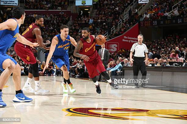 Kyrie Irving of the Cleveland Cavaliers drives to the basket against Klay Thompson of the Golden State Warriors during the game on December 25 2016...