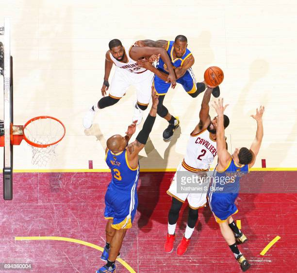 Kyrie Irving of the Cleveland Cavaliers drives to the basket and shoots the ball against the Golden State Warriors in Game Four of the 2017 NBA...