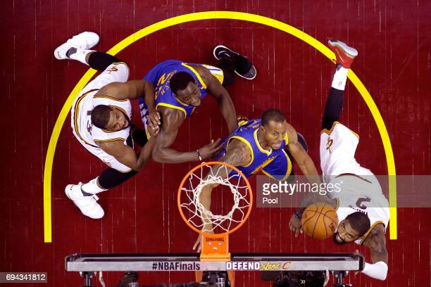 Kyrie Irving of the Cleveland Cavaliers drives to the basket in the second quarter against Andre Iguodala of the Golden State Warriors in Game 4 of...