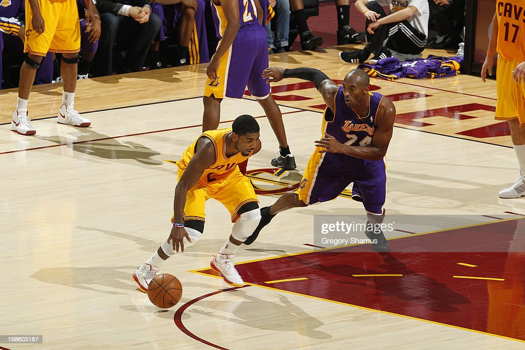Kyrie Irving #2 of the Cleveland Cavaliers drives to the hoop against Kobe Bryant #24 of the Los Angeles Lakers at The Quicken Loans Arena on December 11, 2012 in Cleveland, Ohio.