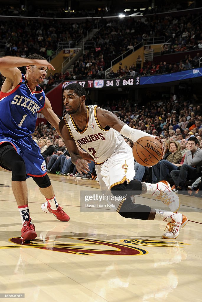38d4927958d2 ... coupon kyrie irving 2 of the cleveland cavaliers drives to the hoop  against michael carter 0fb76