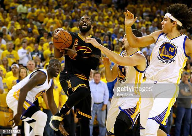 Kyrie Irving of the Cleveland Cavaliers drives to the hoop against the Golden State Warriors in Game 7 of the 2016 NBA Finals at ORACLE Arena on June...