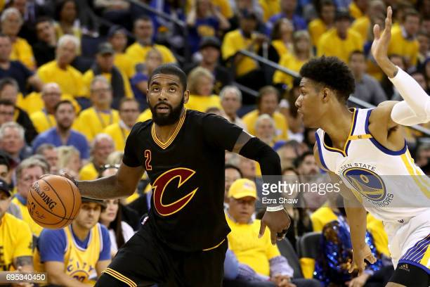 Kyrie Irving of the Cleveland Cavaliers drives with the ball against Patrick McCaw of the Golden State Warriors in Game 5 of the 2017 NBA Finals at...