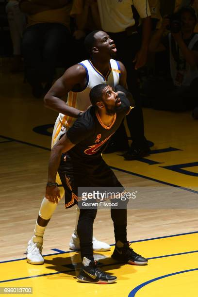 Kyrie Irving of the Cleveland Cavaliers fights for position against Draymond Green of the Golden State Warriors in Game Five of the 2017 NBA Finals...