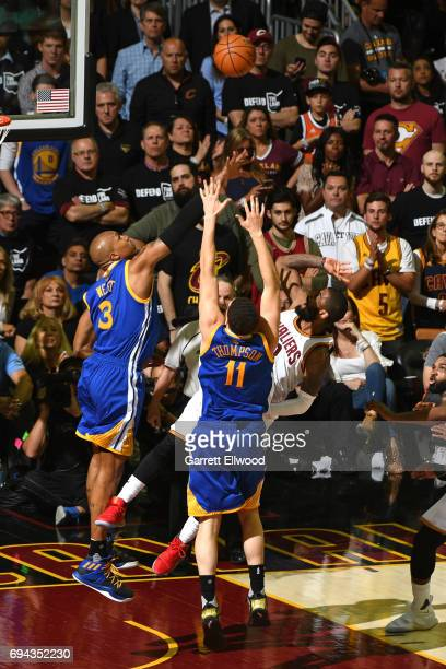 Kyrie Irving of the Cleveland Cavaliers flips up a shot over David West of the Golden State Warriors in Game Four of the 2017 NBA Finals on June 9...