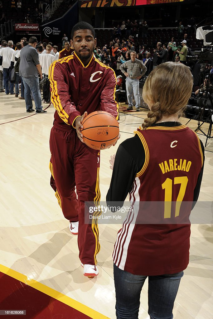 Kyrie Irving #2 of the Cleveland Cavaliers gives a ball to a fan before the game against the Boston Celtics at The Quicken Loans Arena on January 22, 2013 in Cleveland, Ohio.