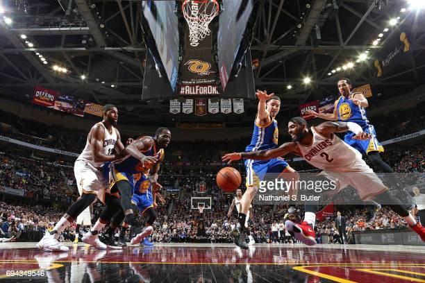 Kyrie Irving of the Cleveland Cavaliers goes for a loose ball against the Golden State Warriors in Game Four of the 2017 NBA Finals on June 9 2017 at...