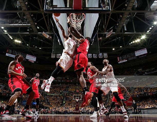 Kyrie Irving of the Cleveland Cavaliers goes for the dunk against Bismack Biyombo of the Toronto Raptors during Game Two of the Eastern Conference...
