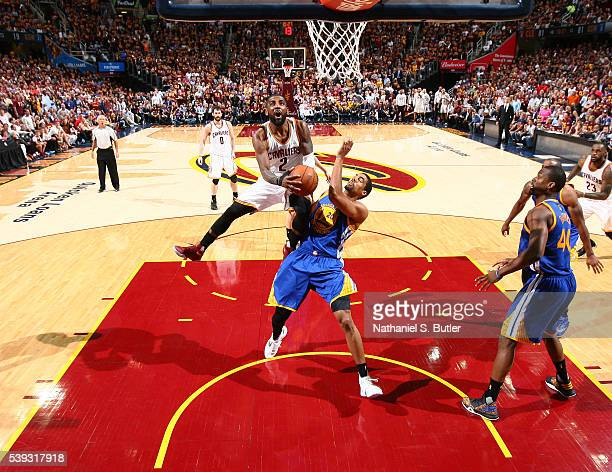 Kyrie Irving of the Cleveland Cavaliers goes for the layup against James Michael McAdoo of the Golden State Warriors during Game Four of the 2016 NBA...