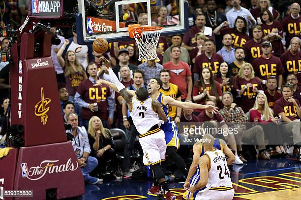 Kyrie Irving of the Cleveland Cavaliers goes for the layup and gets blocked by Klay Thompson of the Golden State Warriors during the game in Game...