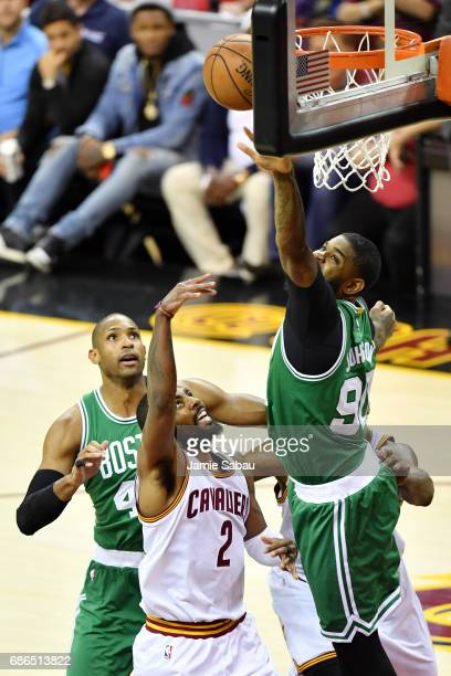 0466ccaefef4 Kyrie Irving of the Cleveland Cavaliers goes up against Amir Johnson of the  Boston Celtics in