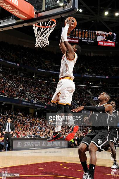 Kyrie Irving of the Cleveland Cavaliers goes up for a dunk against the Brooklyn Nets during the game on December 19 2014 at Quicken Loans Arena in...