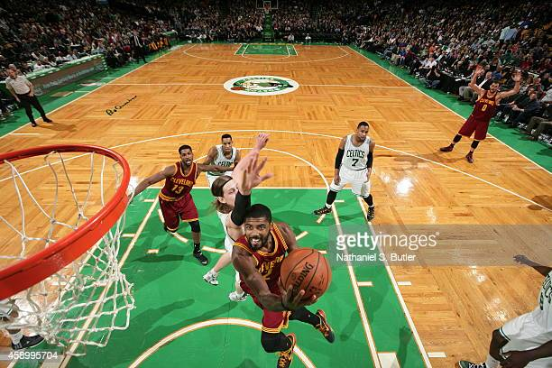 Kyrie Irving of the Cleveland Cavaliers goes up for a shot against the Boston Celtics on November 14 2014 at the TD Garden in Boston Massachusetts...