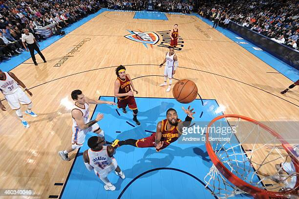 Kyrie Irving of the Cleveland Cavaliers goes up for a shot against the Oklahoma City Thunder at Chesapeake Energy Arena on December 11 2014 in...
