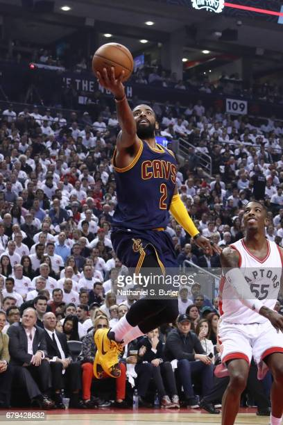 Kyrie Irving of the Cleveland Cavaliers goes up for a shot against the Toronto Raptors during Game Three of the Eastern Conference Semifinals of the...