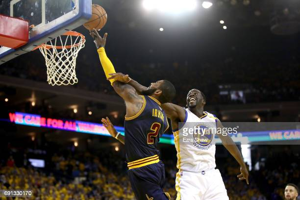Kyrie Irving of the Cleveland Cavaliers goes up for a shot against Draymond Green of the Golden State Warriors in Game 1 of the 2017 NBA Finals at...