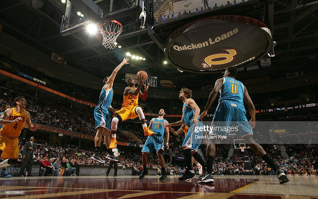 Kyrie Irving #2 of the Cleveland Cavaliers goes up for the shot against Ryan Anderson #33 of the New Orleans Hornets at The Quicken Loans Arena on February 20, 2013 in Cleveland, Ohio.