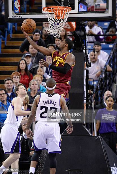 Kyrie Irving of the Cleveland Cavaliers goes up to attempt a reverse layup against the Sacramento Kings at Sleep Train Arena on January 12 2014 in...