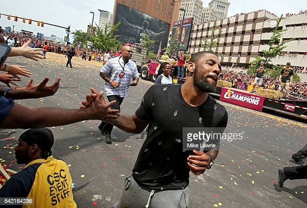 Kyrie Irving of the Cleveland Cavaliers greets fans during the Cleveland Cavaliers 2016 NBA Championship victory parade and rally on June 22 2016 in...