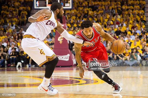 Kyrie Irving of the Cleveland Cavaliers guards Derrick Rose of the Chicago Bulls in the second half during Game One in the Eastern Conference...