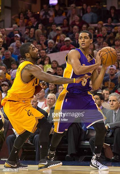 Kyrie Irving of the Cleveland Cavaliers guards Jordan Clarkson of the Los Angeles Lakers during the first half at Quicken Loans Arena on February 8...