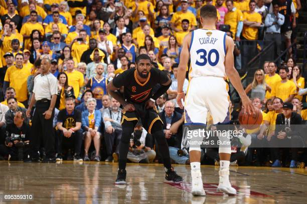 Kyrie Irving of the Cleveland Cavaliers guards Stephen Curry of the Golden State Warriors in Game Five of the 2017 NBA Finals on June 12 2017 at...